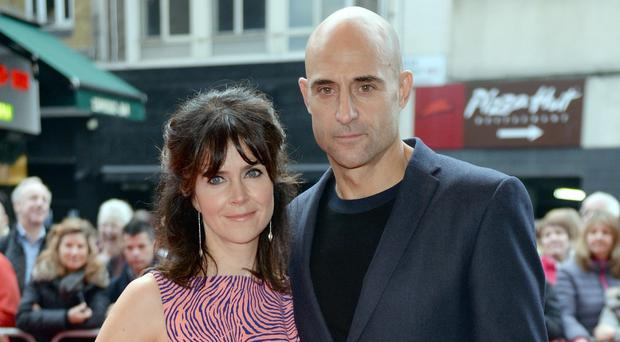 Liza Marshall and Mark Strong attend the premiere of Get Santa at the Vue West End cinema in central London