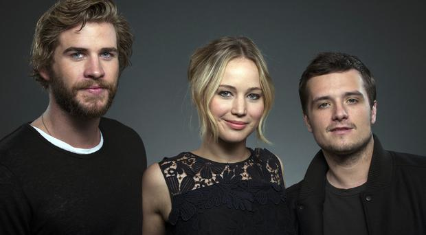 Liam Hemsworth, Jennifer Lawrence and Josh Hutcherson star in the Hunger Games films