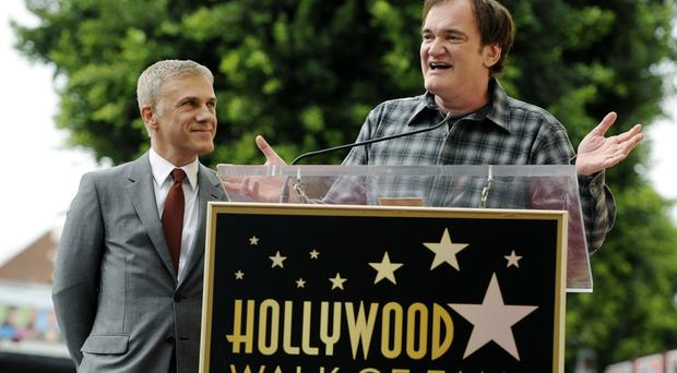 Quentin Tarantino addresses the crowd during a ceremony to honor Christoph Waltz with a star on the Hollywood Walk of Fame (AP/Invision)