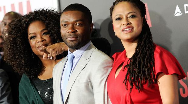 Oprah Winfrey poses with David Oyelowo and Carmen Ejogo at the premiere of Selma