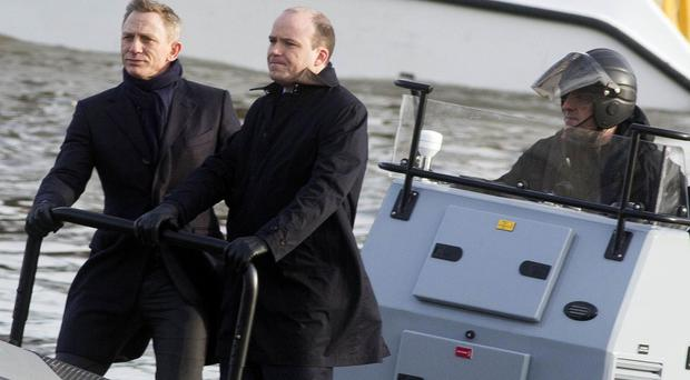 Daniel Craig and Rory Kinnear film Spectre on the River Thames