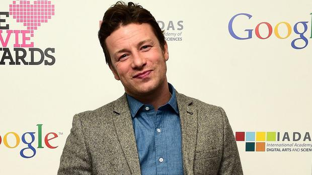 Jamie Oliver has called for a Singapore-style ban on chewing gum in public after accusing people who spit it out of making Britain look like a