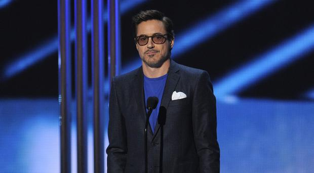 Robert Downey Jr accepts the award for favourite movie actor at the People's Choice Awards in Los Angeles (Invision/AP)