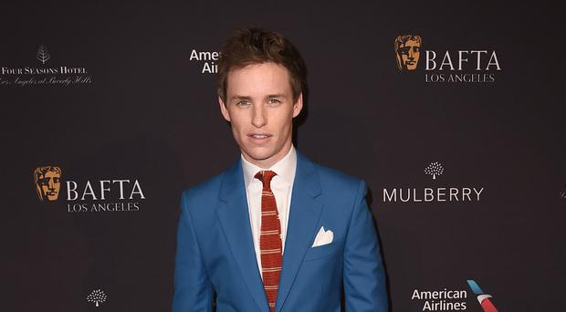 Eddie Redmayne arrives at the Bafta 2015 awards season tea party at The Four Seasons Hotel. (AP)