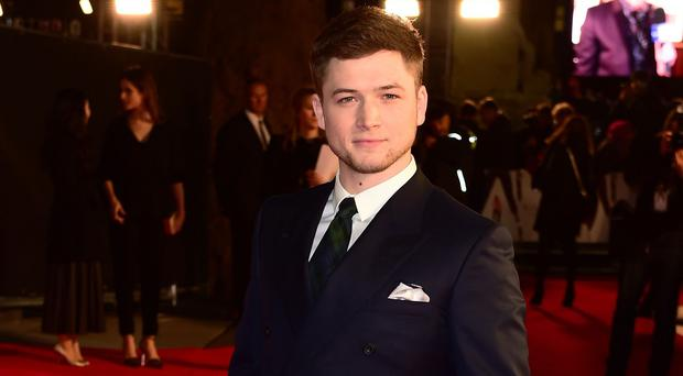 Taron Egerton has admitted he is afraid of dogs