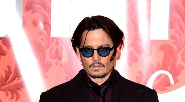 Johnny Depp attending the premiere of Mortdecai at the Empire Cinema, Leicester Square