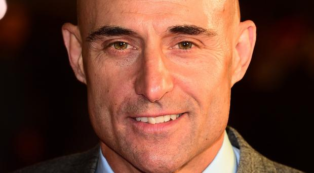 Mark Strong stars with Sacha Baron Cohen in Grimsby