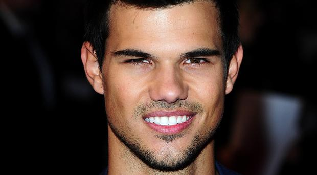 Taylor Lautner has joined the cast of Adam Sandler's first Netflix film