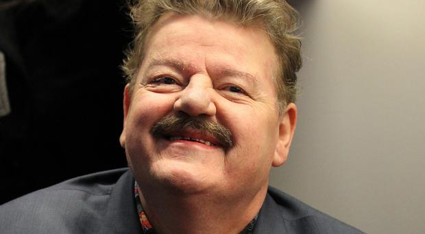 Robbie Coltrane was taken to hospital after falling ill while travelling