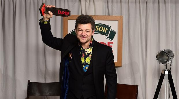 Andy Serkis receives the Best Actor Award at the Jameson Empire Film Awards 2015.