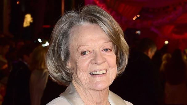 Dame Maggie Smith will upgrade from Downton Abbey to Windsor Castle as a guest of the Queen