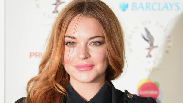 Lindsay Lohan must complete 115 hours of community service before the end of the month