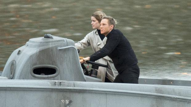 A Daniel Craig stunt double performs in a scene from the new James Bond film