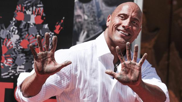 Dwayne Johnson at his Hand And Footprint Ceremony in Los Angeles (Invision/AP)