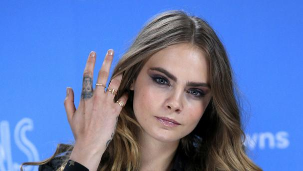 Cara Delevingne attending the Paper Towns photo call at Claridges Hotel, London