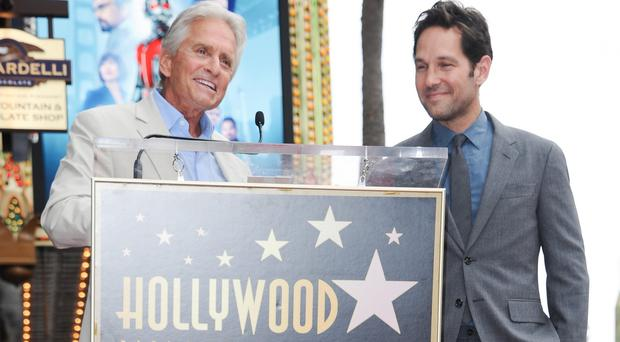 Michael Douglas, left, and Paul Rudd at a ceremony honouring Rudd with a star on the Hollywood Walk of Fame (Invision/AP)