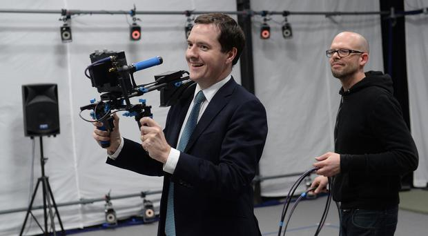 George Osborne tries out a virtual camera on a visit to Ealing Studios in west London
