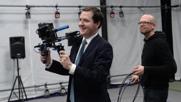 George Osborne tries out a virtual camera on a visit to Ealing Studios in west London.
