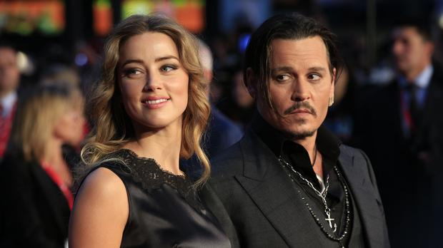 Johnny Depp and wife Amber Heard at the premiere of Black Mass