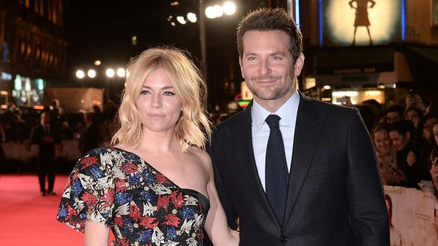 Sienna Miller and Bradley Cooper arrive for the Burnt premiere