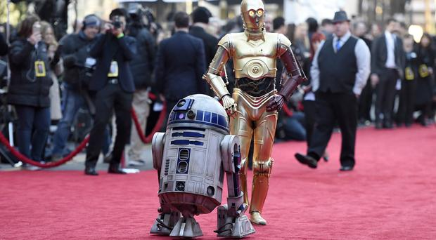 R2D2, left, and C-3PO arrive at the TCL Chinese Theatre (Invision/AP)