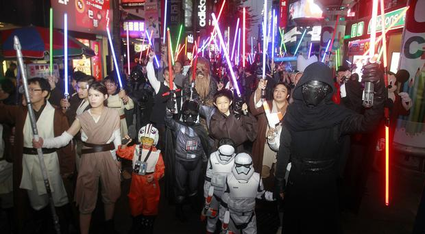 Star Wars: The Force Awakens brought in 238 million US dollars (£159 million) over the weekend (AP)