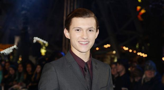 Tom Holland arriving for the European premiere of In the Heart of the Sea at the Empire, Leicester Square in London