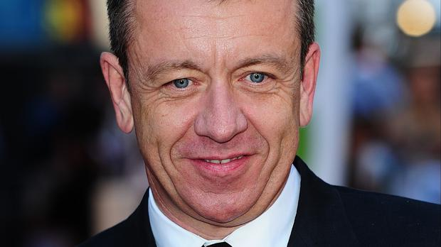 "Peter Morgan said he was ""delighted and proud"" to be receiving a CBE"