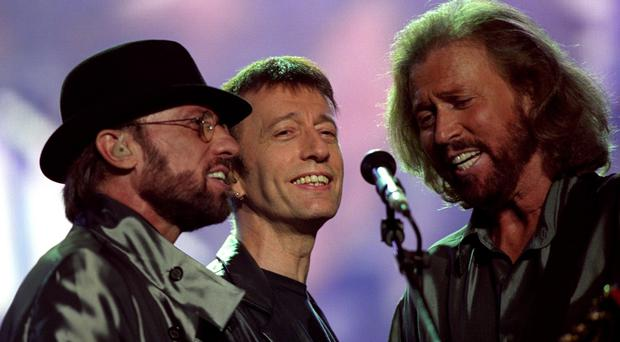 The Bee Gees were managed by Robert Stigwood, who has died aged 81