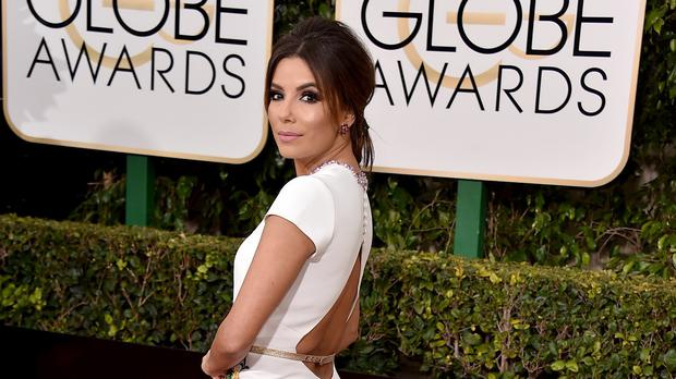 Eva Longoria wore a white Georges Hobeika gown at the Golden Globes