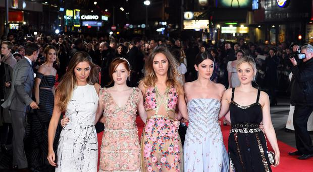 From left, Hermione Cornfield, Ellie Bamber, Suki Waterhouse, Millie Brady and Bella Heathcoate attend the Pride and Prejudice and Zombies European premiere in Leicester Square, London