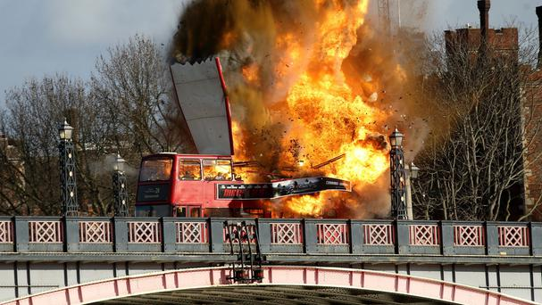 A bus explodes on Lambeth Bridge in London during filming for Jackie Chan's new film The Foreigner
