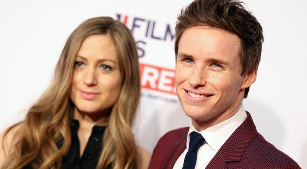 Eddie Redmayne, pictured with wife Hannah Bagshawe, has tipped Leorardo DiCaprio to win this year's best actor Oscar (Invision/AP)