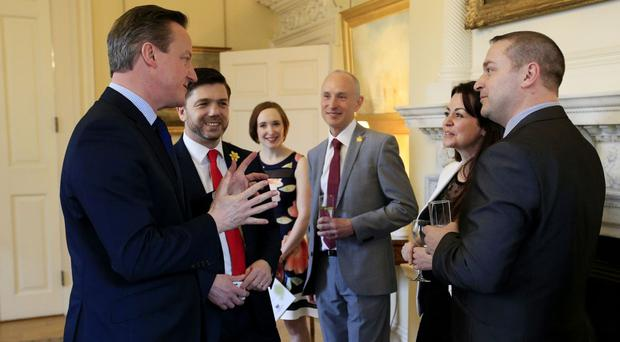 Prime Minister David Cameron, accompanied by Welsh Secretary Stephen Crabb (second left), hosts a St David's Day reception at Number 10, Downing Street in London.