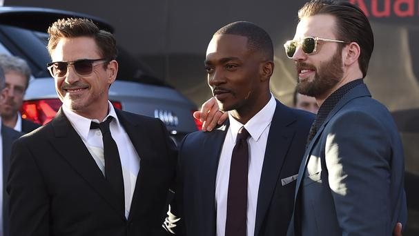Robert Downey Jr, Anthony Mackie and Chris Evans arrive at the Los Angeles premiere of Captain America: Civil War (AP)