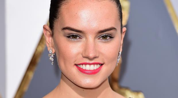 Daisy Ridley will accompany the Duke of Cambridge and Prince Harry around the Star Wars set