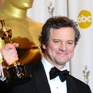 Colin Firth with the Best Actor award, received for The King's Speech, at the 83rd Academy Awards