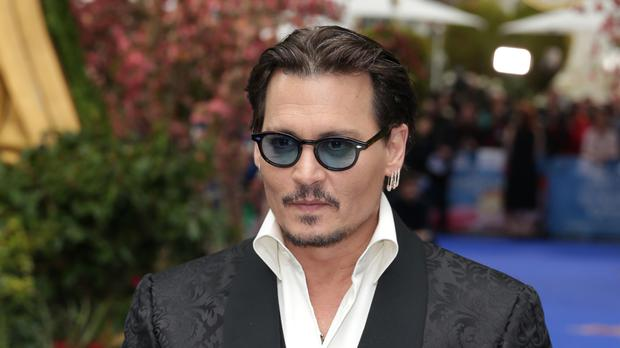 Johnny Depp arrives at the Alice Through The Looking Glass European premiere