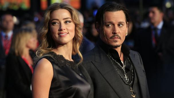 Actor Johnny Depp and his wife Amber Heard, who are divorcing after 15 months of marriage