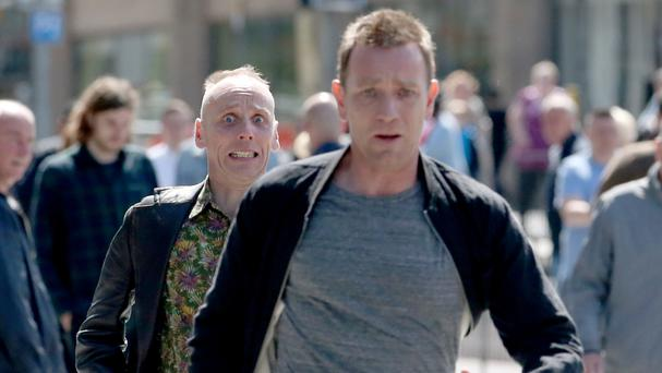 Ewan McGregor, front, and Ewan Bremner speed through the streets of Edinburgh