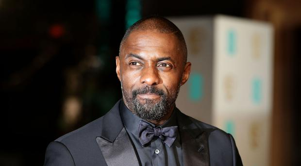 Idris Elba put the finishing touches to a Star Trek mural
