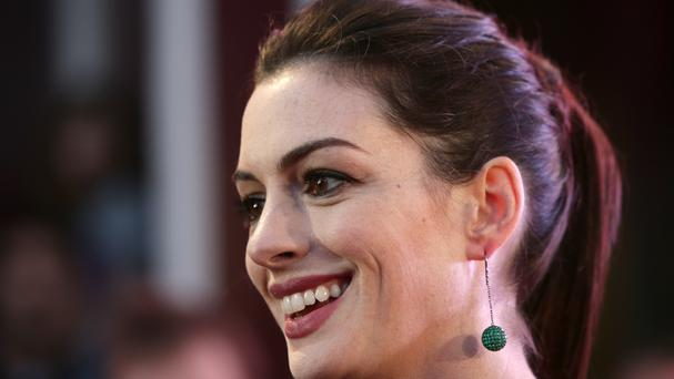 Anne Hathaway has a positive message for new mums.