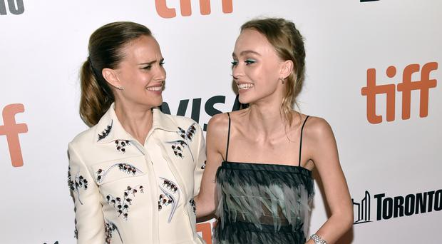 Natalie Portman and Lily-Rose Depp arrive at the Planetarium premiere at the Toronto International Film Festival (Invision/AP)