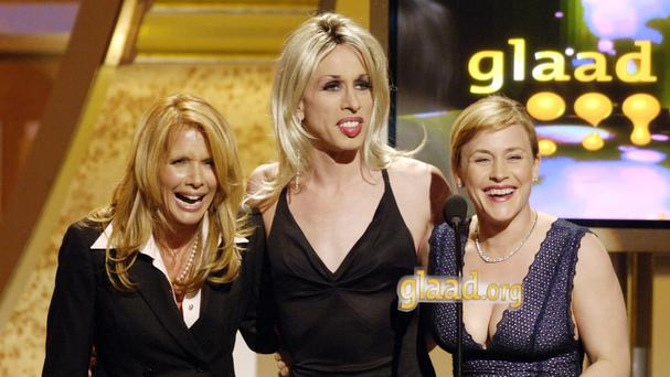 Alexis Arquette, centre, at an event with sisters Rosanna and Patricia (AP)
