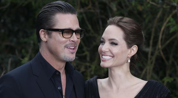 Brad Pitt and Angelina Jolie during happier times