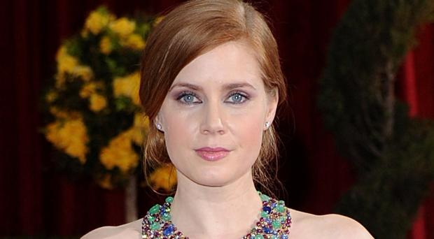 Amy Adams plays a professor of linguistics enlisted to decipher the language of extraterrestrials