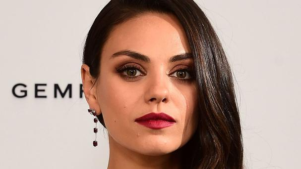 Mila Kunis said the producer told her 'you'll never work in this town again' when she refused to take part in the provocative photo-shoot