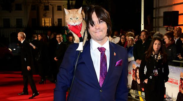 James Bowen and Bob attending the world premiere of A Street Cat Named Bob
