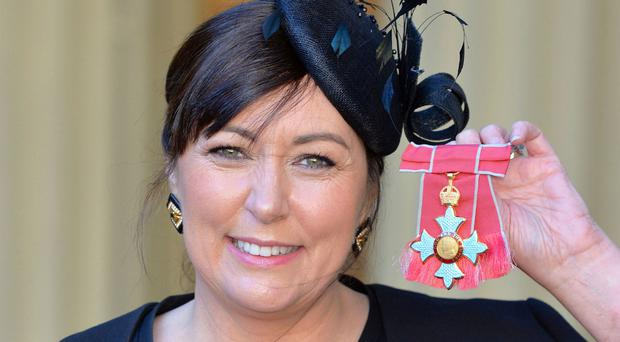 Lynwen Brennan with the CBE presented to her by the Prince of Wales at Buckingham Palace