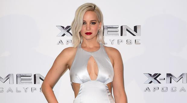 Jennifer Lawrence struggles to hold a tune but can strike emotion in others, according to co-star Chris Pratt